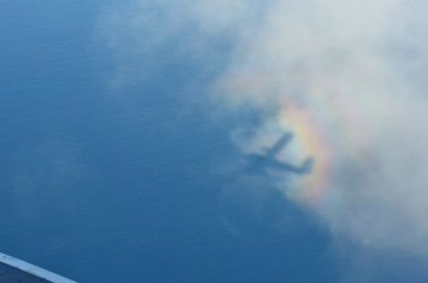 That's our plane's shadow! Plus a rainbow...?