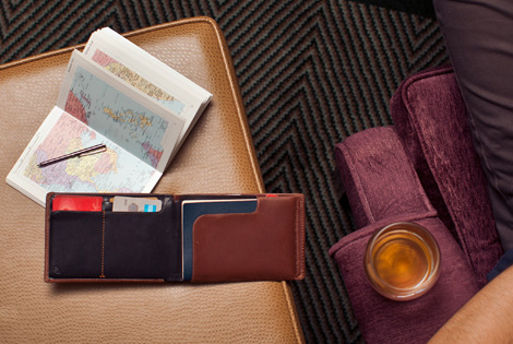 Travel wallet comes in both black and brown.